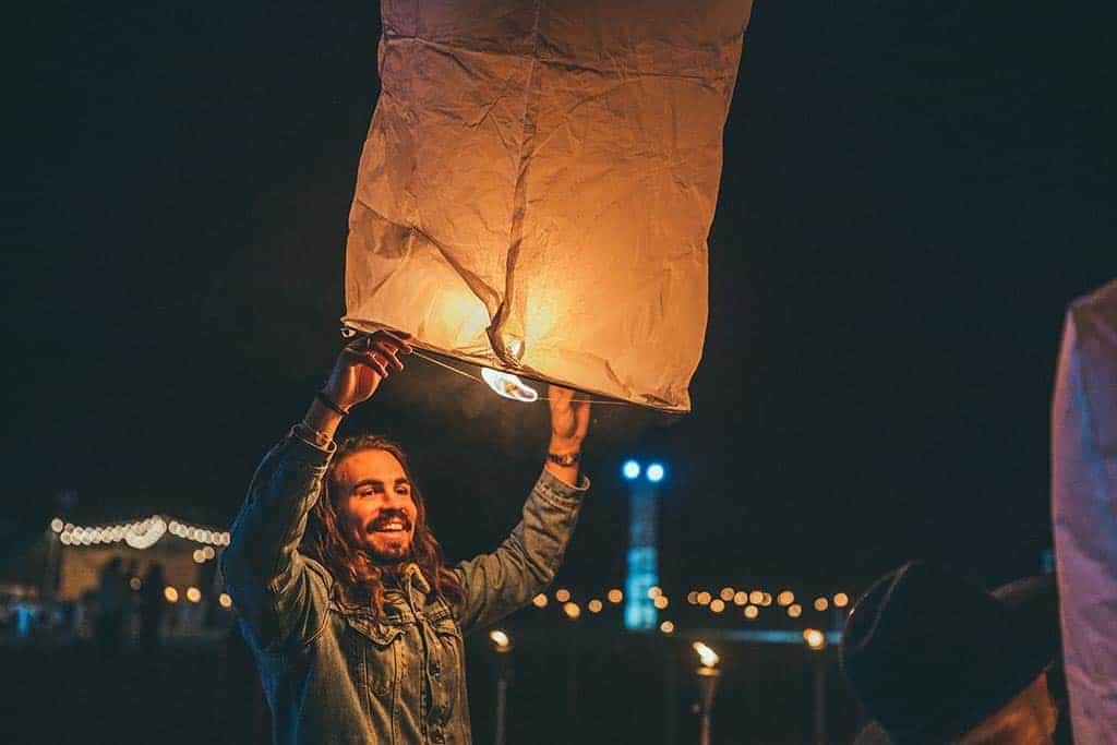 backpacker sending off a lantern at Loy Krathong lantern festival in Chiang Mai