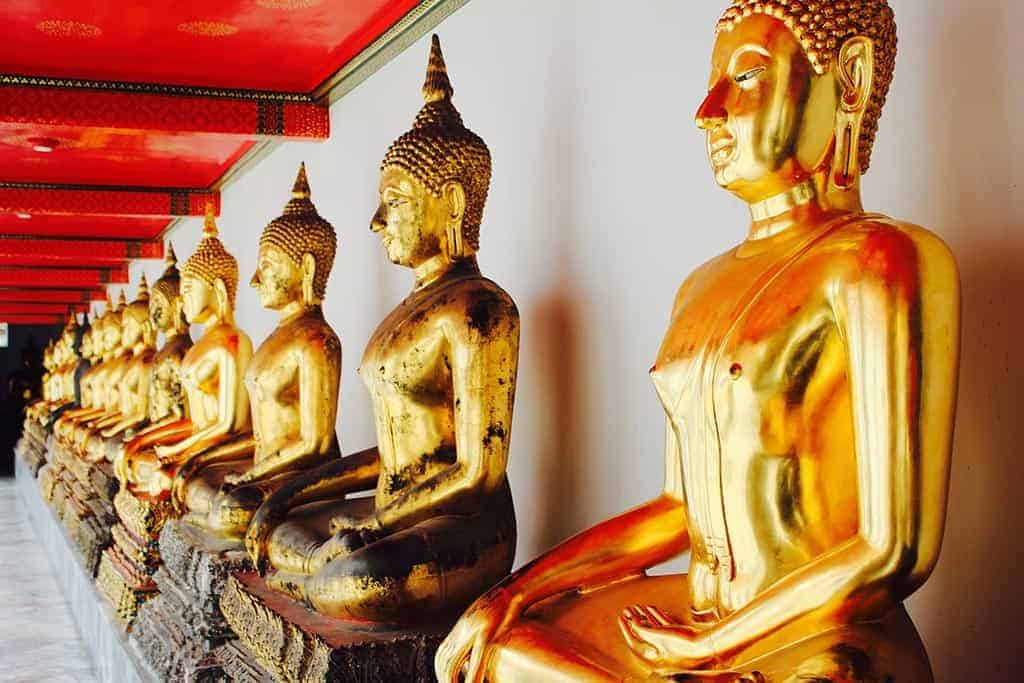 golden Buddha statues at the Bangkok Grand Palace